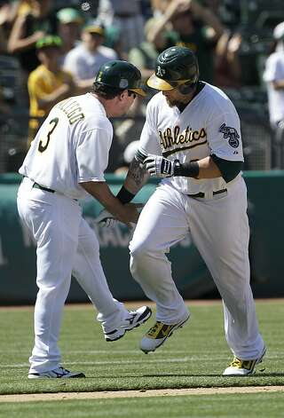 Oakland Athletics' Jonny Gomes, right, celebrates with third base coach Mike Gallego (3) after hitting a two-run home run off of San Diego Padres pitcher Luke Gregerson during the seventh inning of a baseball game in Oakland, Calif., Saturday, June 16, 2012. The Athletics won 6-4. (AP Photo/Jeff Chiu) Photo: Jeff Chiu, Associated Press