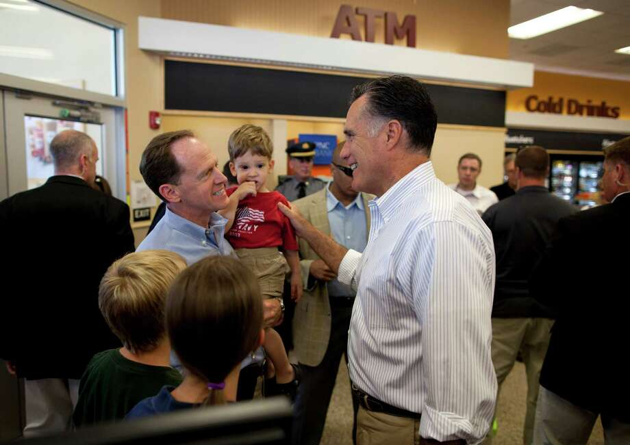 Republican presidential candidate, former Massachusetts Gov. Mitt Romney, right, talks with Sen. Patrick Toomey, R- Pa., during a stop at Wawa gas station in  in Quakertown, Pa., Saturday, June 16, 2012.  (AP Photo/Evan Vucci) Photo: Evan Vucci