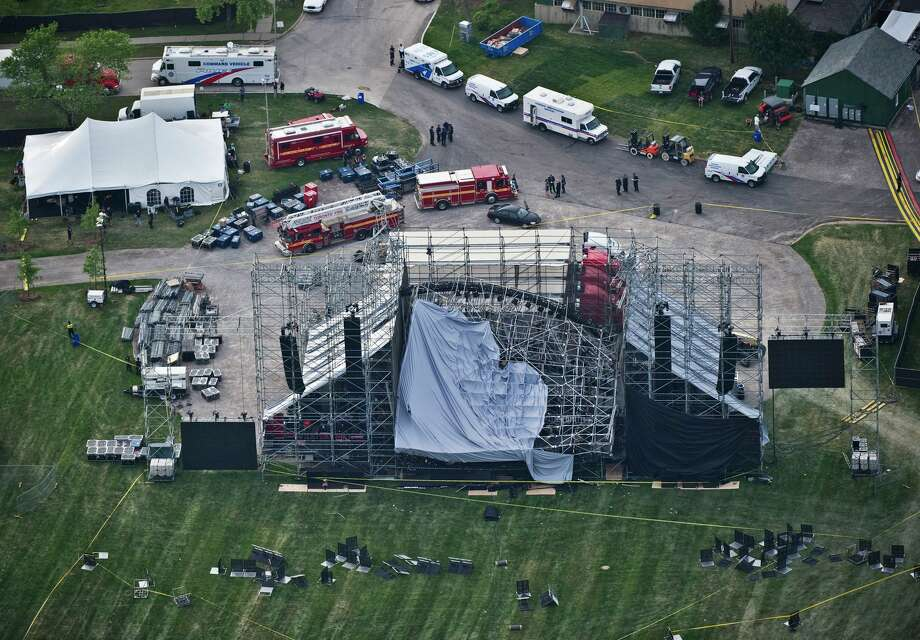 This aerial view shows a collapsed concert stage at Downsview Park in Toronto, Saturday, June 16, 2012. The top of a stage being set up for a concert by band Radiohead collapsed, killing one of the stage workers preparing for the event. Photo: Associated Press