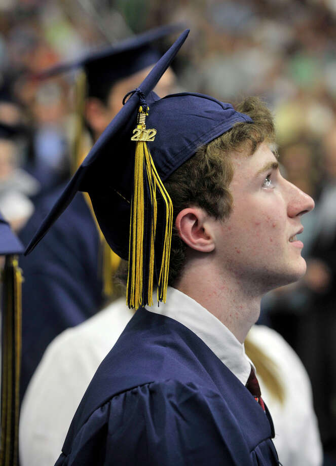 Tyler Abbondondolo looks to the flag as the Star Spangled Banner is played during the Brookfield High School graduation in the O'Neill Center at Western Connecticut State University's westside campus in Danbury on Saturday, June 16, 2012. Photo: Jason Rearick / The News-Times