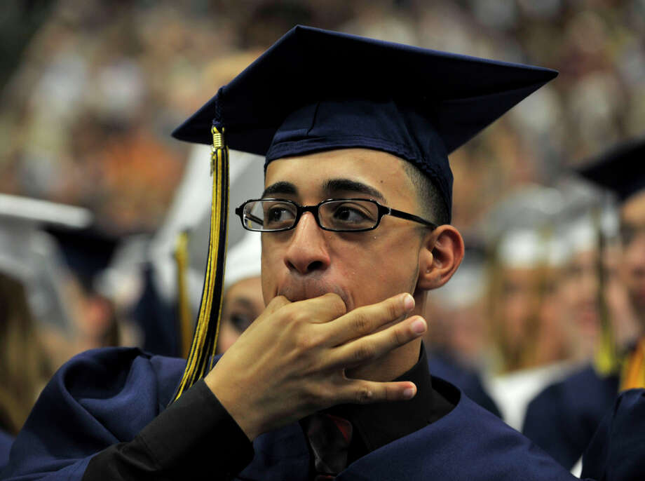 Karim Abdelkader whistles during the Brookfield High School graduation in the O'Neill Center at Western Connecticut State University's westside campus in Danbury on Saturday, June 16, 2012. Photo: Jason Rearick / The News-Times