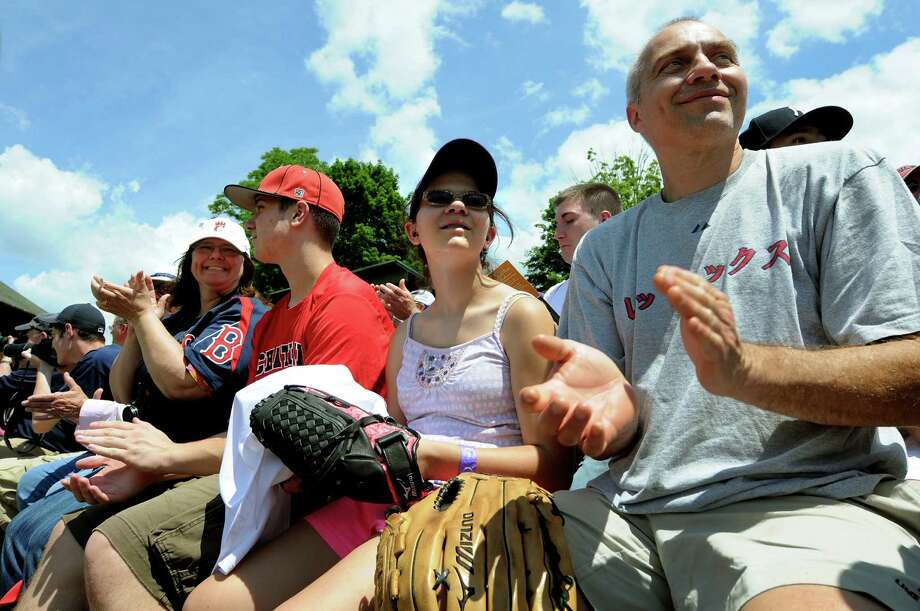 Baseball fan Steve Engel of Chatham, right, joins his daughter, Amara, 13, son Sam, 15, and wife Karen for the annual Hall of Fame Classic old-timers baseball game on Saturday, June 16, 2012, at Double Day Field in Cooperstown, N.Y. The Engels were there as part of their Father's Day weekend activities. (Cindy Schultz / Times Union) Photo: Cindy Schultz / 00018089A