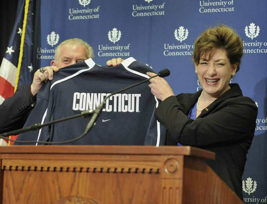 Larry McHugh, Chairman of the Board of Trustees at UConn, left, and Susan Herbst, newly named president of the University of Connecticut hold up a Connecticut jersey during a news conference in Storrs, Conn., Monday, Dec. 20, 2010. Photo: Jessica Hill, Jessica Hill/Associated Press / Associated Press