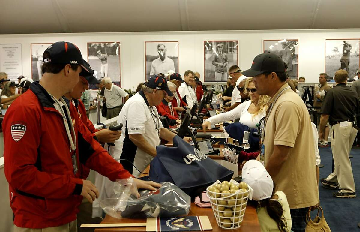 Cashiers check out merchandise, at the Merchandise PAvilion, at the Olympic Club in San Francisco, Ca., on Tuesday June 12, 2012. Officials at the U.S. Open expect to sell $15 million worth of clothing and trinkets from the 36,000-square-foot Merchandise Pavilion during the United States Open Championship.