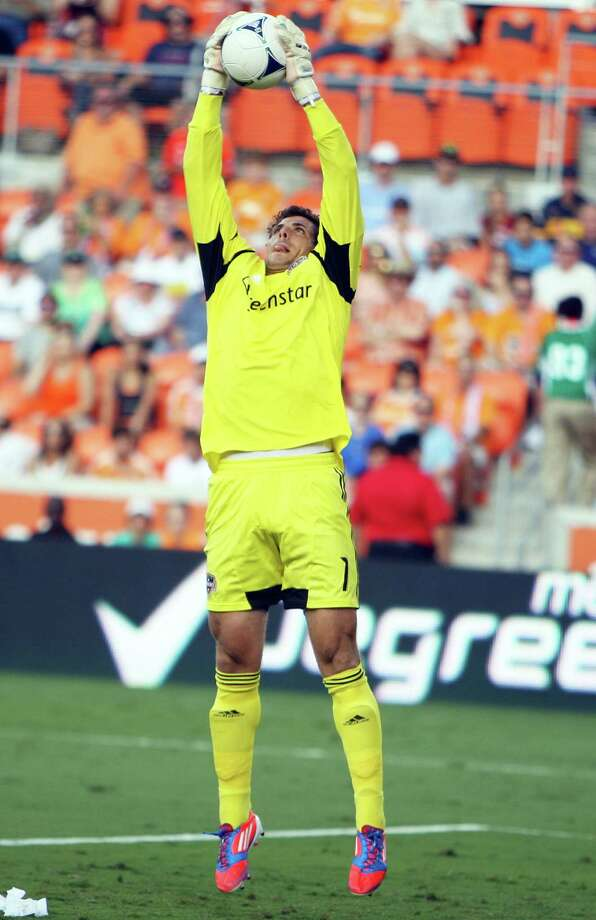 The Houston Dynamo goalkeeper Tally Hall blocks a goal attempt by FC Dallas during the first half of MLS game action at BBVA Compass Stadium Saturday, June 16, 2012, in Houston. Photo: James Nielsen, Chronicle / © Houston Chronicle 2012