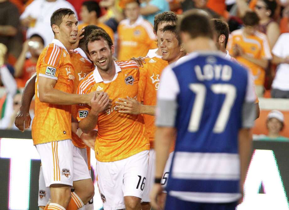 The Houston Dynamo midfielder Adam Moffat center, celebrates with teammates after scoring a goal during the second of MLS game action against FC Dallas at BBVA Compass Stadium Saturday, June 16, 2012, in Houston. Photo: James Nielsen, Chronicle / © Houston Chronicle 2012