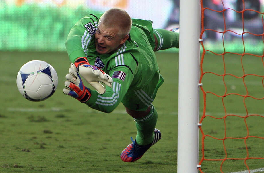 FC Dallas goalkeeper Kevin Hartman blocks a goal attempt by the Houston Dynamo during the second of MLS game action at BBVA Compass Stadium Saturday, June 16, 2012, in Houston. Photo: James Nielsen, Chronicle / © Houston Chronicle 2012