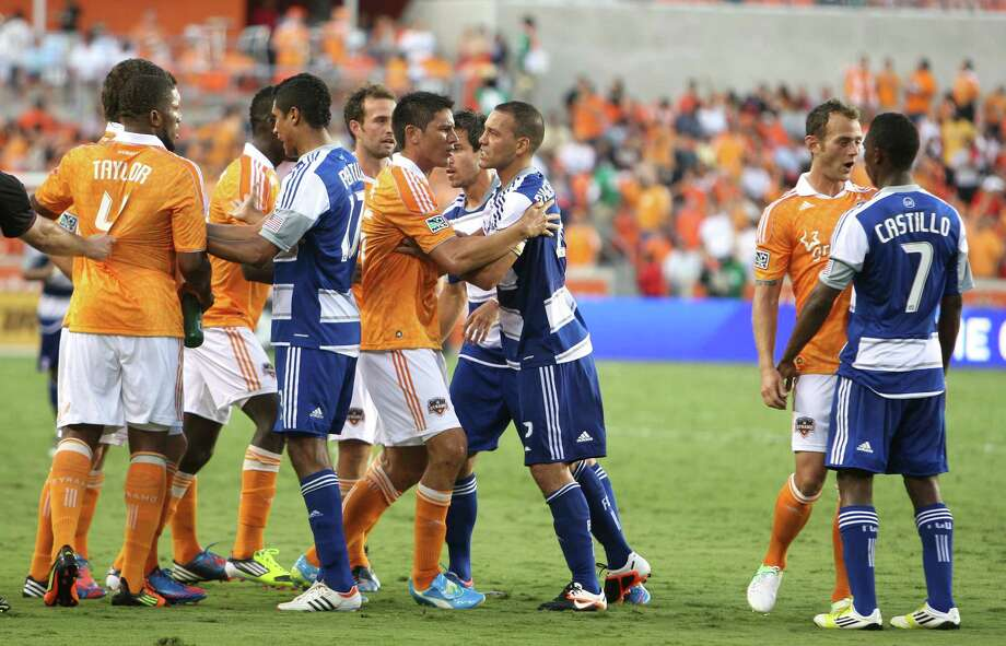 Houston Dynamo players and FC Dallas players push and shove after the FC Dallas defender Jair Benitez received a red card during the second of MLS game action at BBVA Compass Stadium Saturday, June 16, 2012, in Houston. Photo: James Nielsen, Chronicle / © Houston Chronicle 2012