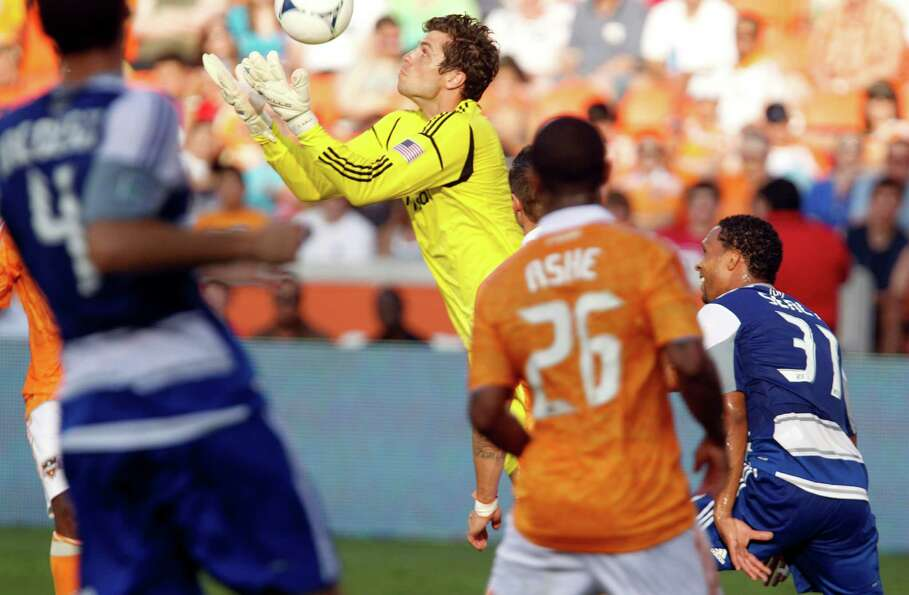The Houston Dynamo goalkeeper Tally Hall center, block a goal attempt by FC Dallas during second hal