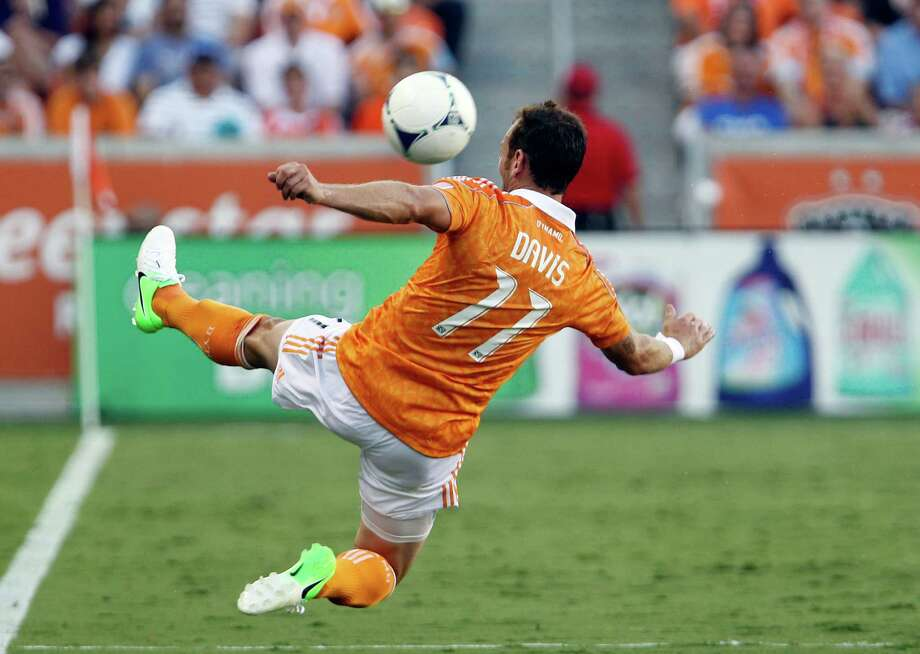 The Houston Dynamo midfielder Brad Davis kicks the ball against FC Dallas during the first half of MLS game action at BBVA Compass Stadium Saturday, June 16, 2012, in Houston. Photo: James Nielsen, Chronicle / © Houston Chronicle 2012