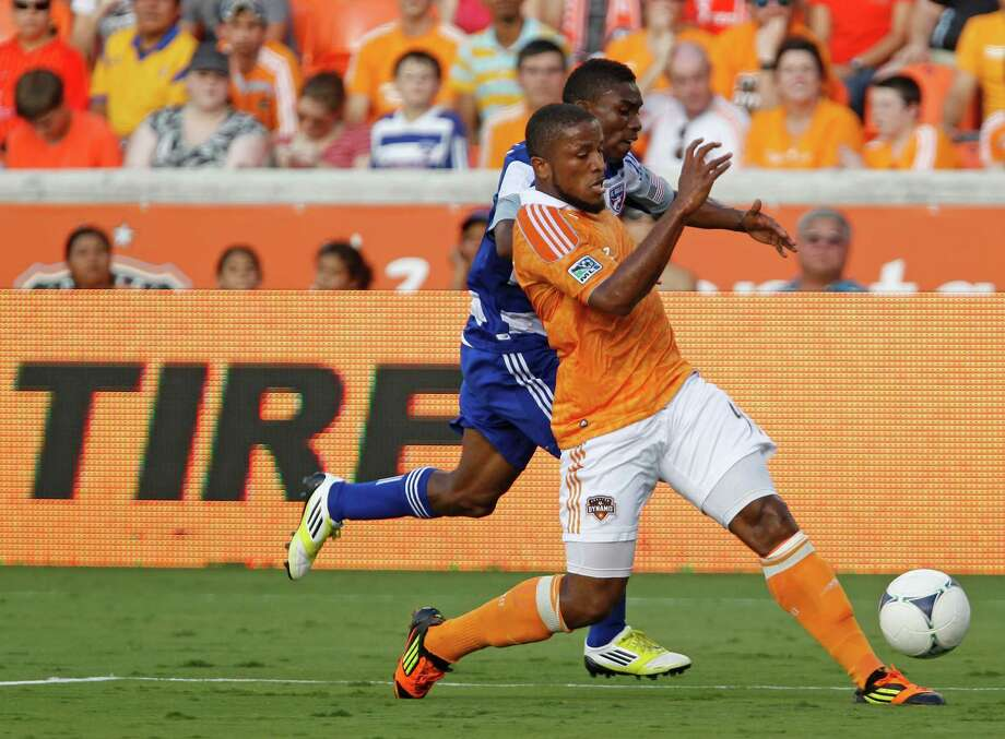 FC Dallas forward Fabian Castillo left, and the Houston Dynamo defender Jermaine Taylor right chase down the ball during the first half of MLS game action at BBVA Compass Stadium Saturday, June 16, 2012, in Houston. Photo: James Nielsen, Chronicle / © Houston Chronicle 2012