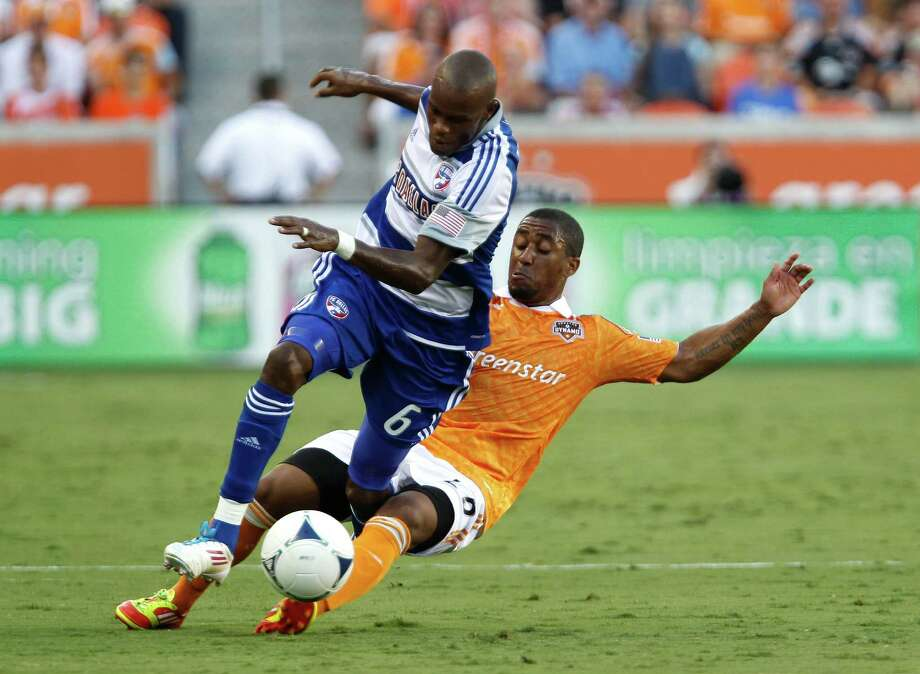 FC Dallas' Jackson Goncalves left, and the Houston Dynamo  Je-Vaughn Watson right, collide during the first half of MLS game action at BBVA Compass Stadium Saturday, June 16, 2012, in Houston. Photo: James Nielsen, Chronicle / © Houston Chronicle 2012