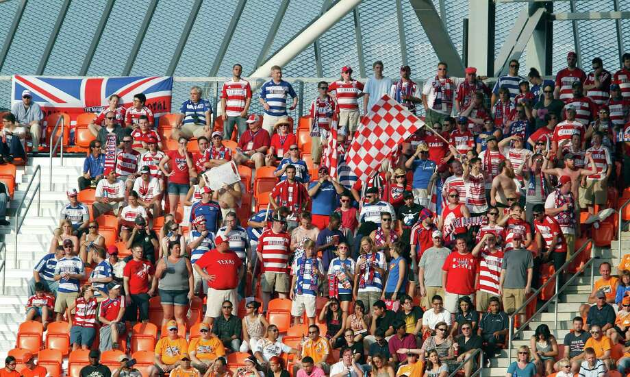 FC Dallas fans cheer as Dallas plays the Houston Dynamo during the first half of MLS game action at BBVA Compass Stadium Saturday, June 16, 2012, in Houston. Photo: James Nielsen, Chronicle / © Houston Chronicle 2012