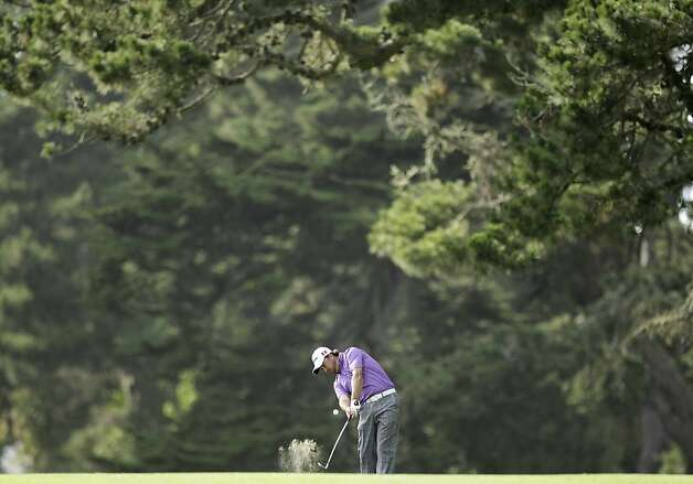Graeme McDowell, of Northern Ireland, hits a shot on the 14th hole during the third round of the U.S. Open Championship golf tournament Saturday, June 16, 2012, at The Olympic Club in San Francisco. (AP Photo/Ben Margot) Photo: Ben Margot, Associated Press