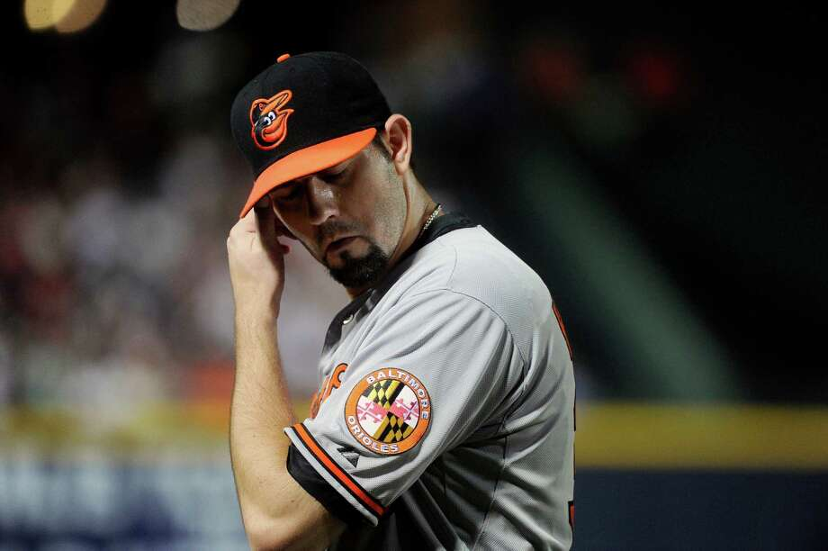 The Orioles' Jason Hammel came close to getting to pitching the sixth no-hitter this season. Photo: AP