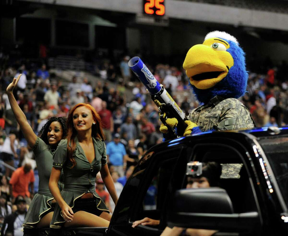 Swoop, the mascot of the San Antonio Talons, and the Sky Dancers circle the arena during arena football action at the Alamodome on Saturday, June 16, 2012.