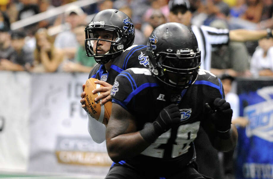 Talons quarterback Aaron Garcia rolls out during arena football action against Iowa at the Alamodome on Saturday, June 16, 2012. Photo: Billy Calzada, Express-News / © 2012 San Antonio Express-News