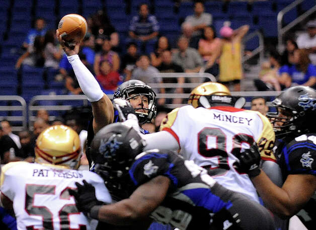 San Antonio Talons quarterback Aaron Garcia throws for a touchdown against the Iowa Barnstormers during arena football action at the Alamodome on Saturday, June 16, 2012. Photo: Billy Calzada, Express-News / © 2012 San Antonio Express-News