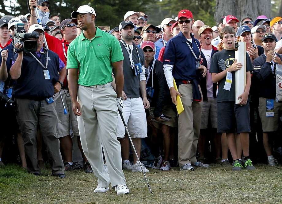 Tiger Woods can't bear to watch his shot from the rough on the right side of the 16th hole. It would hit a tree branch, and Woods would bogey the hole. Photo: Michael Macor, The Chronicle