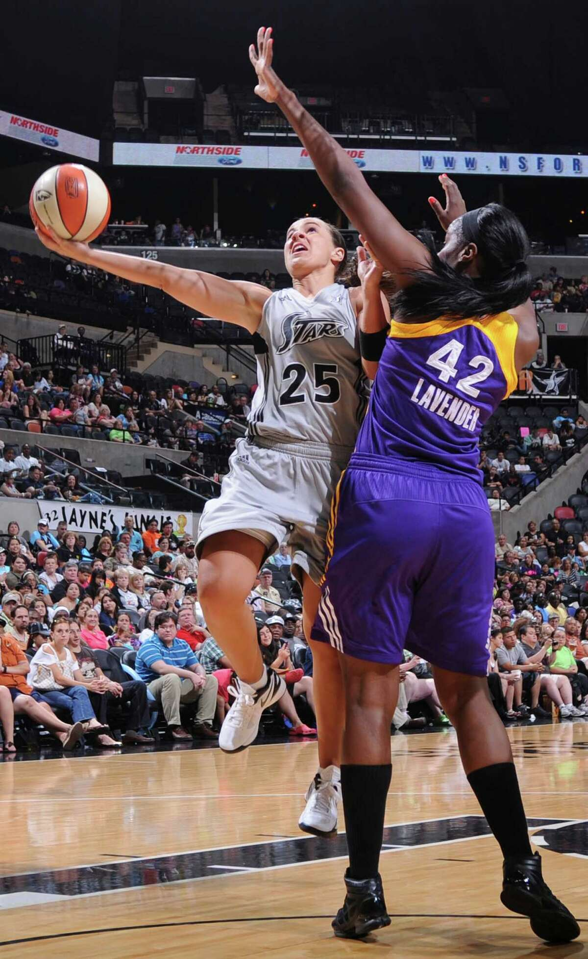 The Silver Stars' Becky Hammon shoots around Sparks' Jantel Lavender during first half action Saturday, June 16, 2012 at the AT&T Center.