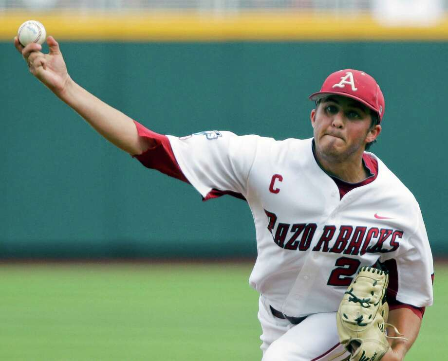 Arkansas starting pitcher DJ Baxendale delivers against Kent State in the first inning of an NCAA College World Series baseball game in Omaha, Neb., Saturday, June 16, 2012. (AP Photo/Nati Harnik) Photo: Nati Harnik
