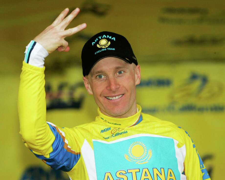 Team Astana's Levi Leipheimer gestures with three fingers to represent his third race win while standing on the podium at the conclusion of Stage 8 of the Tour of California cycling race in Escondido, Calif., on Feb. 22, 2009. Photo: Marcio Jose Sanchez / AP