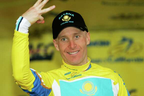 Team Astana's Levi Leipheimer gestures with three fingers to represent his third race win while standing on the podium at the conclusion of Stage 8 of the Tour of California cycling race in Escondido, Calif., Sunday, Feb. 22, 2009. (AP Photo/Marcio Jose Sanchez)
