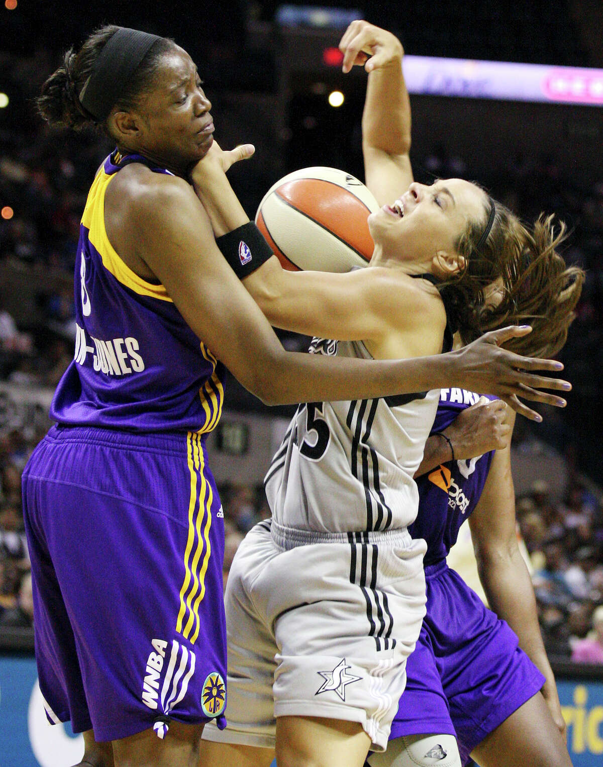 The Silver Stars' Becky Hammon looks for room between Sparks' Delisha Milton-Jones (left) and Sparks' Alana Beard (rear) during second half action Saturday, June 16, 2012 at the AT&T Center. The Stars won 98-85 in overtime.