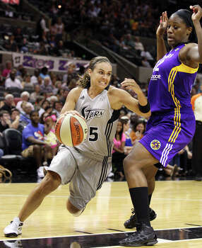 The Silver Stars' Becky Hammon looks for room around Sparks' Jantel Lavender during first half action Saturday, June 16, 2012 at the AT&T Center. Photo: Edward A. Ornelas, Express-News / © 2012 San Antonio Express-News