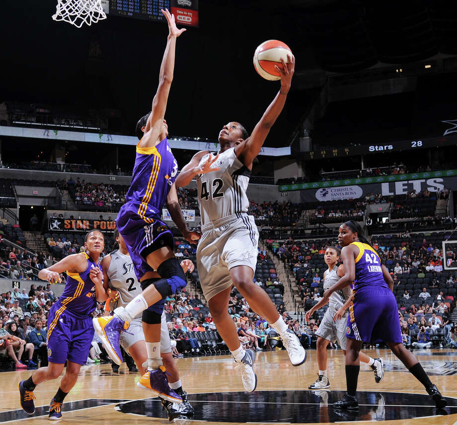 The Silver Stars' Shenise Johnson shoots around Sparks' Candace Parker during first half action Saturday, June 16, 2012 at the AT&T Center. Photo: Edward A. Ornelas, Express-News / © 2012 San Antonio Express-News