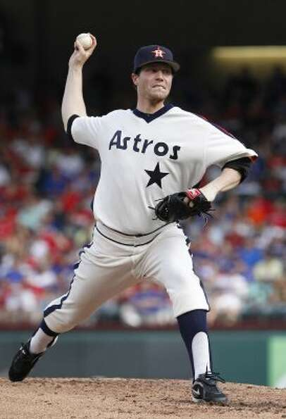 June 16: Rangers 8, Astros 3  Lucas Harrell throws during the first i