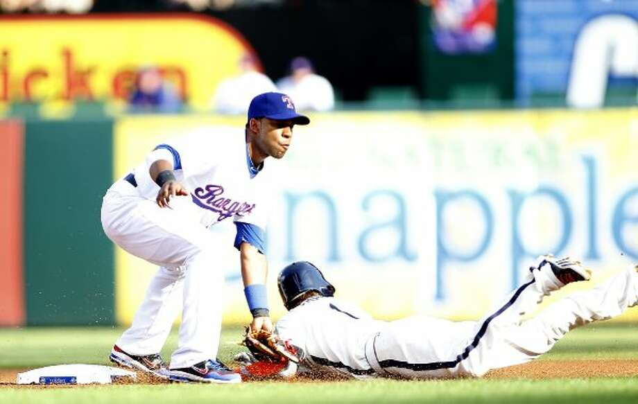 Jordan Schafer is tagged out by Elvis Andrus.  (Rick Yeatts / 2012 Getty Images)