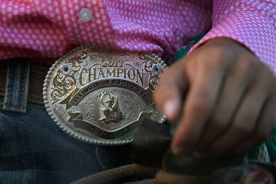 ALTAMONT, IL - JUNE 16:  Brett Schewe wears a championship belt buckle from a previous rodeo event while competing at the Illinois High School Rodeo Association State Finals on June 16, 2012 in Altamont, Illinois. Winners in the competition will go on to compete in the high school national championships July 15-21 in Rock Springs, Wyoming.  (Photo by Scott Olson/Getty Images) Photo: Scott Olson, Getty Images