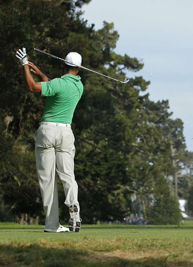 Tiger Woods lets go of his club after a not so good shot on the fourteenth hole, during the third round of the United States Open Championship being played at the Olympic Club in San Francisco, Ca., on Saturday June 16, 2012. Photo: Michael Macor, The Chronicle
