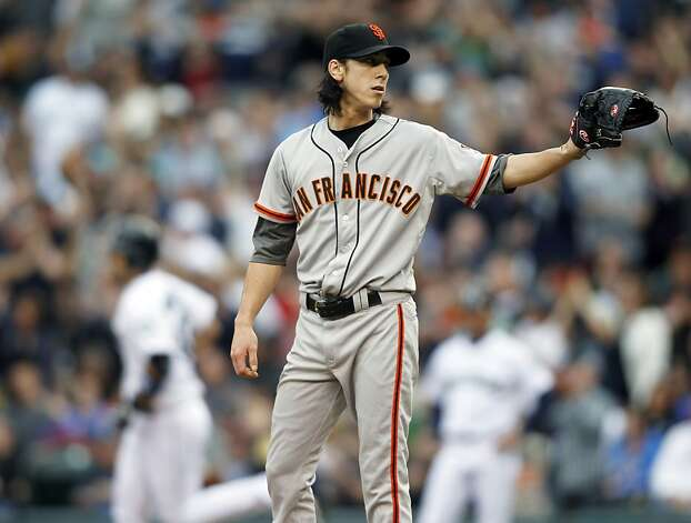 San Francisco Giants' pitcher Tim Lincecum waits for a ball while Seattle Mariners' Jesus Montero rounds the bases after hitting a solo home run during the first inning of a baseball game in Seattle, Saturday, June 16, 2012. (AP Photo/John Froschauer) Photo: John Froschauer, Associated Press