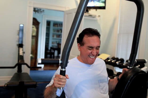 Henry Cisneros exercises at his home on Tuesday, June 12, 2012. He alternates cardio and weights to exercise most days of the week. Photo: Lisa Krantz, San Antonio Express-News / 2012 San Antonio Express-News
