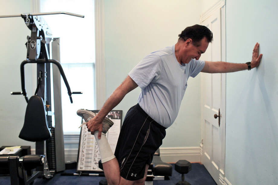 Henry Cisneros stretches before running on a treadmill at his home on Tuesday, June 12, 2012. He alternates cardio and weights to exercise most days of the week. Photo: Lisa Krantz, San Antonio Express-News / 2012 San Antonio Express-News