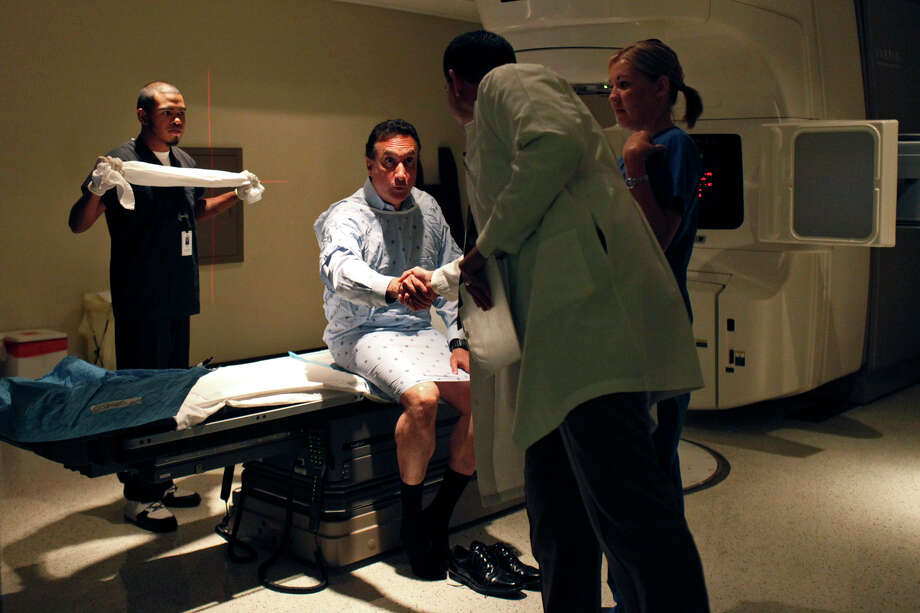 Dr. Michael A. Selva, a radiation oncologist, says goodbye to Henry Cisneros before Cisneros' daily radiation treatment after their weekly appointment at San Antonio Center for Cancer Treatment on Tuesday, June 12, 2012. Photo: Lisa Krantz, San Antonio Express-News / 2012 San Antonio Express-News