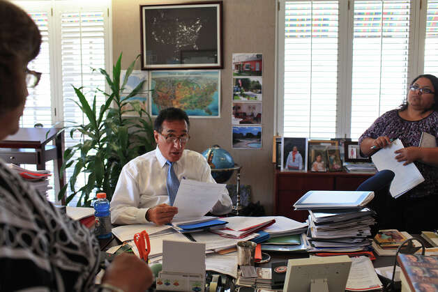 Henry Cisneros works with his administrative assistants Andrea Sotello, right, and Nora Clark, left, at CityView on Wednesday, June 6, 2012. Photo: Lisa Krantz, San Antonio Express-News / 2012 San Antonio Express-News