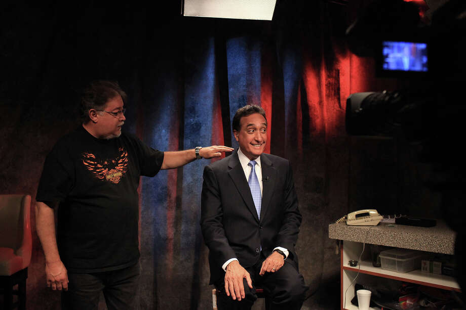 Operations Supervisor Rick Zamora, left, gets Henry Cisneros ready to appear on the Fox Business Network as a live guest at KABB FOX 29 in San Antonio on Wednesday, June 6, 2012. Photo: Lisa Krantz, San Antonio Express-News / 2012 San Antonio Express-News