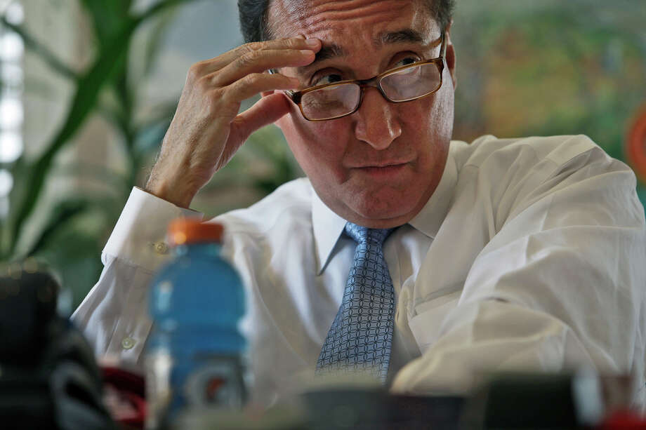 Henry Cisneros participates in a conference call with the U.S.-Mexico Foundation Board Meeting at his CityView office on Wednesday, June 6, 2012. Photo: Lisa Krantz, San Antonio Express-News / 2012 San Antonio Express-News