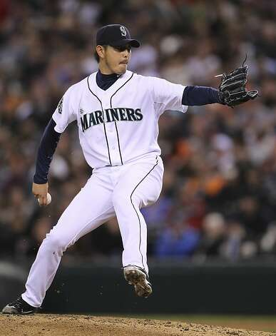 SEATTLE, WA - JUNE 16:  Relief pitcher Hisashi Iwakuma #18 of the Seattle Mariners pitches against the San Francisco Giants at Safeco Field on June 16, 2012 in Seattle, Washington. (Photo by Otto Greule Jr/Getty Images) Photo: Otto Greule Jr, Getty Images