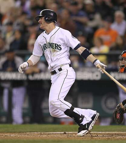 SEATTLE, WA - JUNE 16:  Brendan Ryan #26 of the Seattle Mariners hits a two RBI single in the sixth inning against the San Francisco Giants at Safeco Field on June 16, 2012 in Seattle, Washington. (Photo by Otto Greule Jr/Getty Images) Photo: Otto Greule Jr, Getty Images