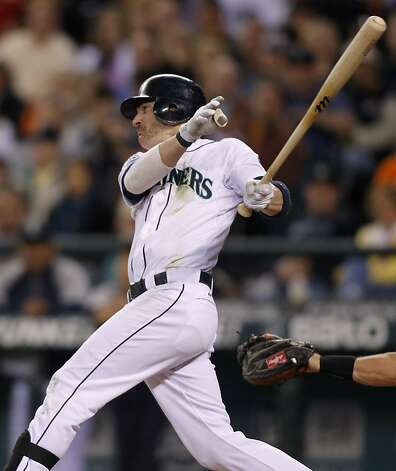 Seattle Mariners' Brendan Ryan hits a 2-RBI single against the San Francisco Giants during the sixth inning of a baseball game in Seattle on Saturday, June 16, 2012. (AP Photo/John Froschauer) Photo: John Froschauer, Associated Press