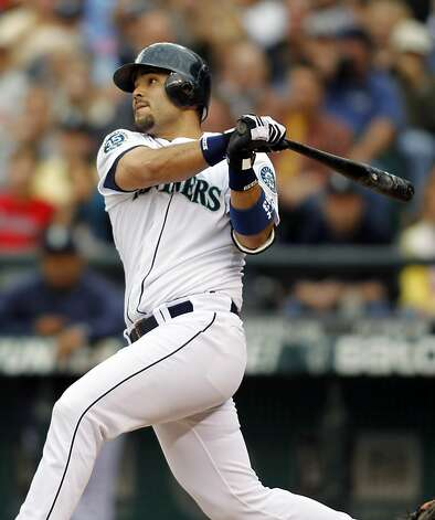 Seattle Mariners' Jesus Montero hits a solo home run on a pitch from San Francisco Giants' Tim Lincecum during the first inning of a baseball game in Seattle, Saturday, June 16, 2012. (AP Photo/John Froschauer) Photo: John Froschauer, Associated Press
