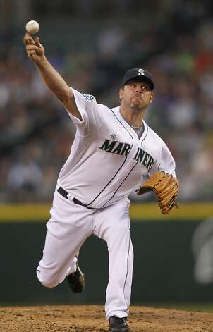 Seattle Mariners' Kevin Millwood pitches against the San Francisco Giants during the third inning of a baseball game in Seattle, Saturday, June 16, 2012. (AP Photo/John Froschauer) Photo: John Froschauer, Associated Press