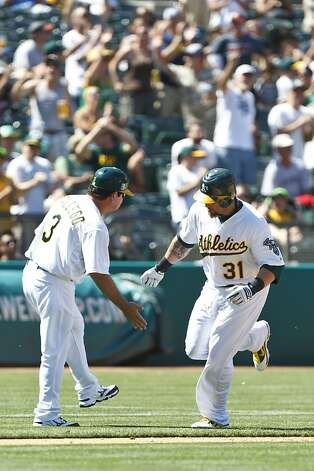 OAKLAND, CA - JUNE 16: Jonny Gomes #31 of the Oakland Athletics is congratulated by third base coach Mike Gallego #3 after hitting a two run home run against the San Diego Padres during the seventh inning of an interleague game at O.co Coliseum on June 16, 2012 in Oakland, California. The Oakland Athletics defeated the San Diego Padres 6-4. (Photo by Jason O. Watson/Getty Images) Photo: Jason O. Watson, Getty Images