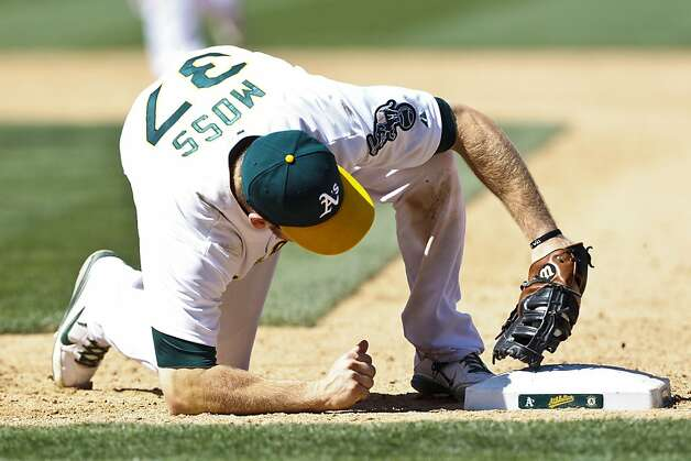 OAKLAND, CA - JUNE 16: Brandon Moss #37 of the Oakland Athletics tags first base for a double play after catching a line drive hit off the bat of Yonder Alonso #23 of the San Diego Padres (not pictured) during the eighth inning of an interleague game at O.co Coliseum on June 16, 2012 in Oakland, California. The Oakland Athletics defeated the San Diego Padres 6-4. (Photo by Jason O. Watson/Getty Images) Photo: Jason O. Watson, Getty Images