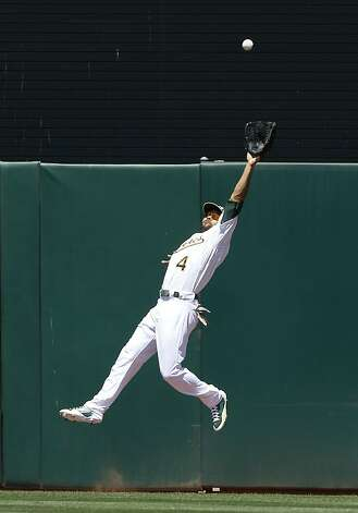 Oakland Athletics left fielder Coco Crisp catches a fly ball hit by San Diego Padres' Cameron Maybin during the fifth inning of a baseball game in Oakland, Calif., Saturday, June 16, 2012. (AP Photo/Jeff Chiu) Photo: Jeff Chiu, Associated Press