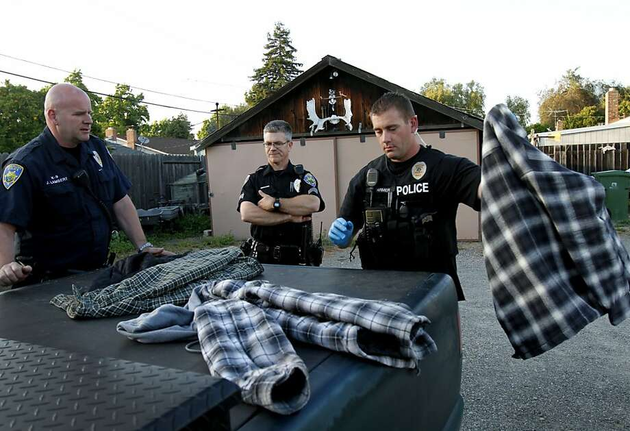 Fremont police officer Keith Farmer, right, Sgt. Barry Fowlie, center, and officer Jason Lambert, left, search a suspect's clothes and truck in Fremont, Calif., Thursday, June 14, 2012.  Fremont saw more than a 20 percent drop in violent crime last year. Photo: Sarah Rice, Special To The Chronicle